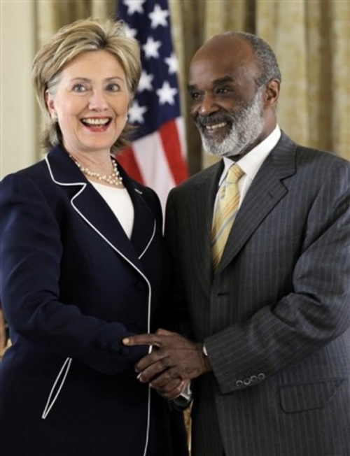 Secretary of state Hillary Clinton and President Preval